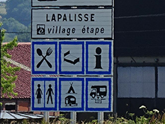 Stop-over village sign